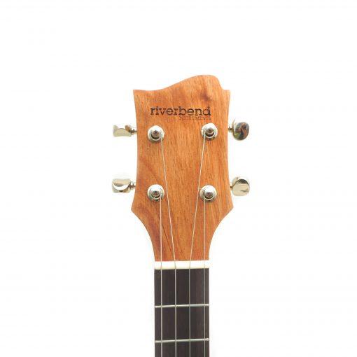 mahogany headstock with riverbend instruments logo