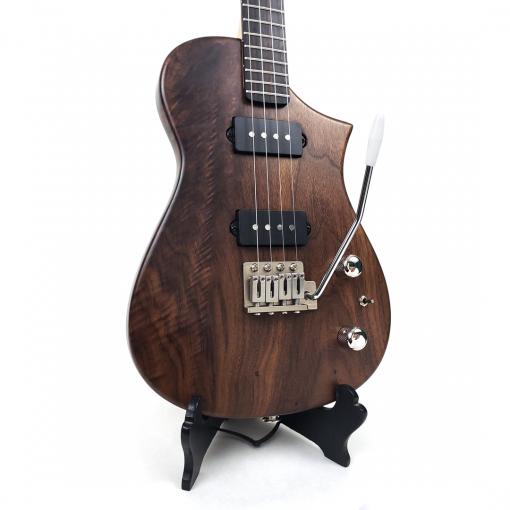 Detail view of walnut tenor ukulele with tremolo