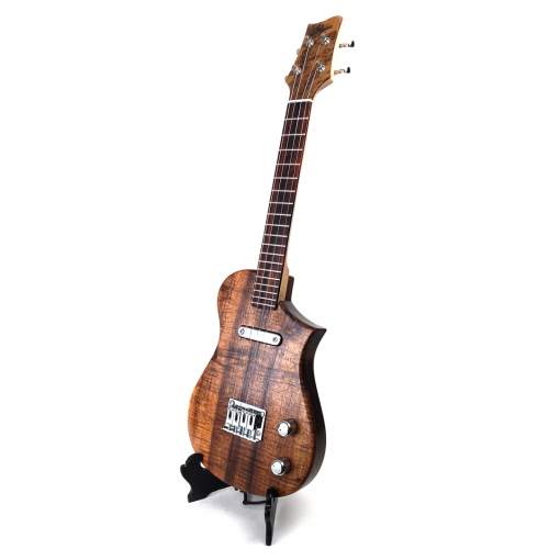 Left view of koa topped concert electric ukulele