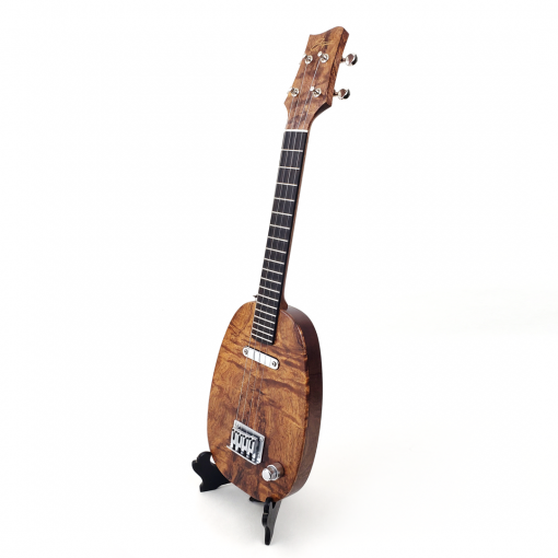Left view of pineapple ukulele in koa